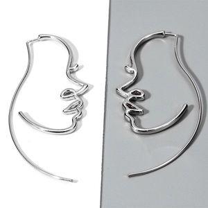 Jewelry - Silver Wire Facial Profile Earrings